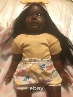 23 Ethnic toddler reborn with 3/4 limbs, cloth body and small box opening